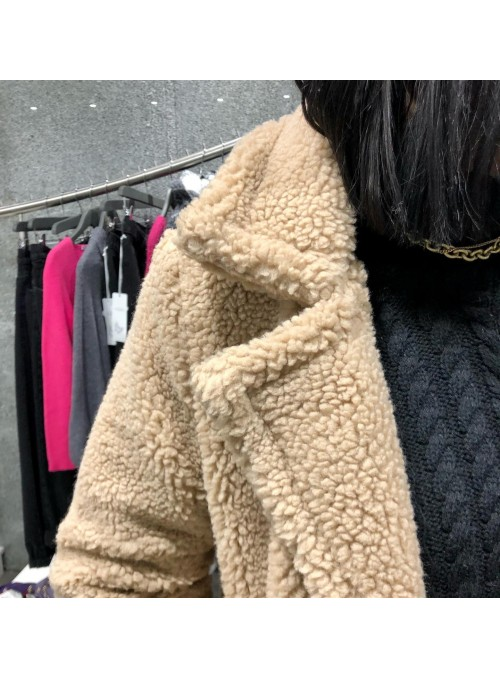 Manteau fausse fourrure beige